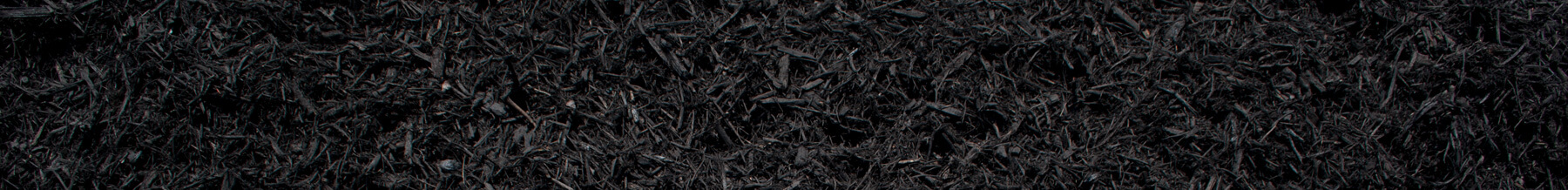close up wide shot of black dyed mulch