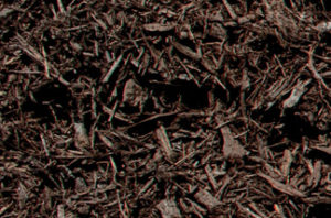 close up of brown dyed mulch