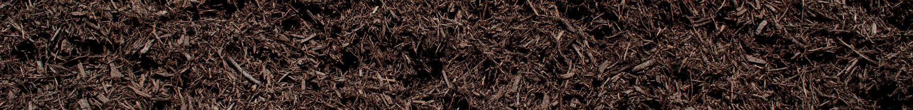 close up wide shot of brown dyed mulch